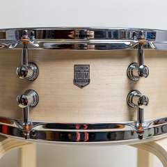 A Maple/Walnut/Maple three ply snare with maple re-rings.