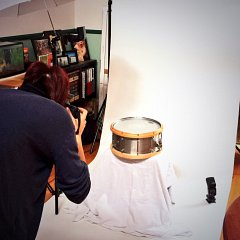 Taking a photo of a snare drum for sale