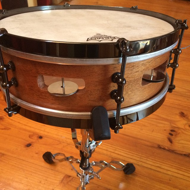A snare drum modified by Schinbein Drum Company
