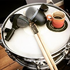 Coffee, drums, microphones. Questions?